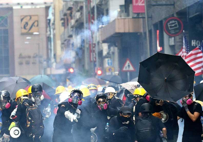 香港反送中嚴重激盪下,讓一國兩制和九二共識均受重創。遠見陳之俊攝影