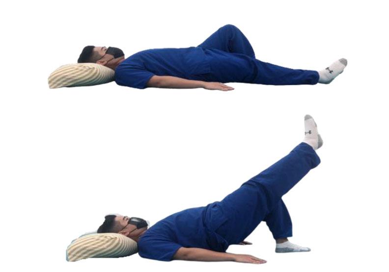 平躺單腳拱橋運動。台灣運動醫學學會提供
