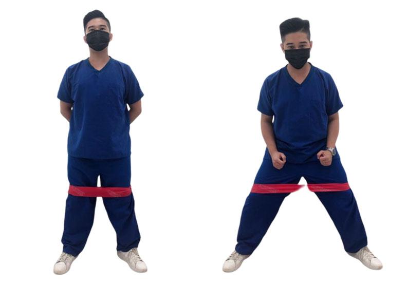 利用彈力帶練習側向走。台灣運動醫學學會提供